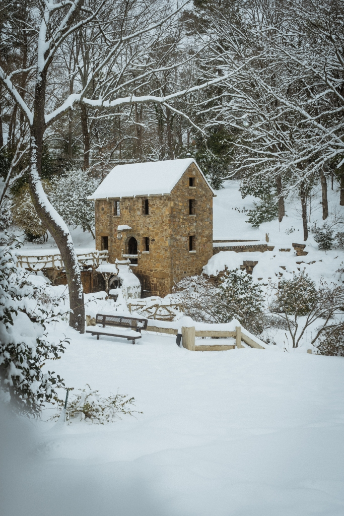 Deep snow covering an old rock building