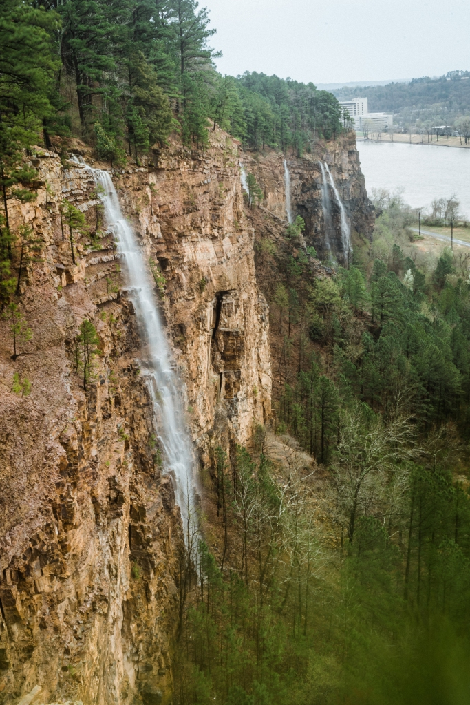Five waterfalls pouring over a rocky cliff