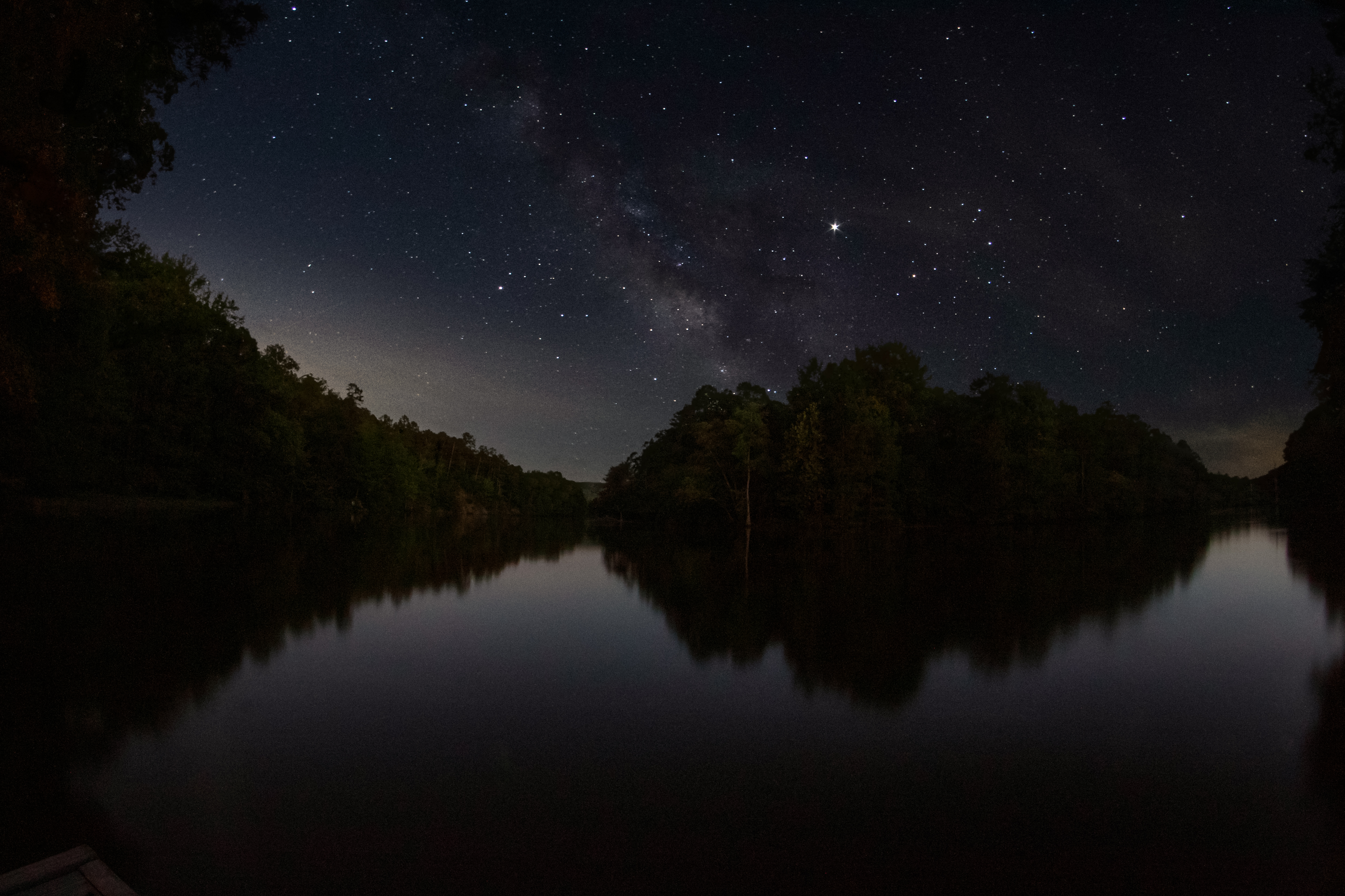 Milky Way night sky over calm waters of the Maumelle River