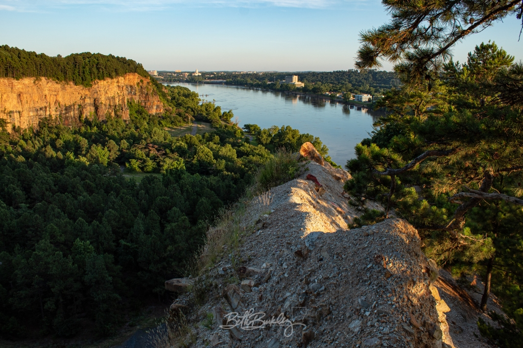 View of cliffs at Emerald Park and downtown Little Rock skyline