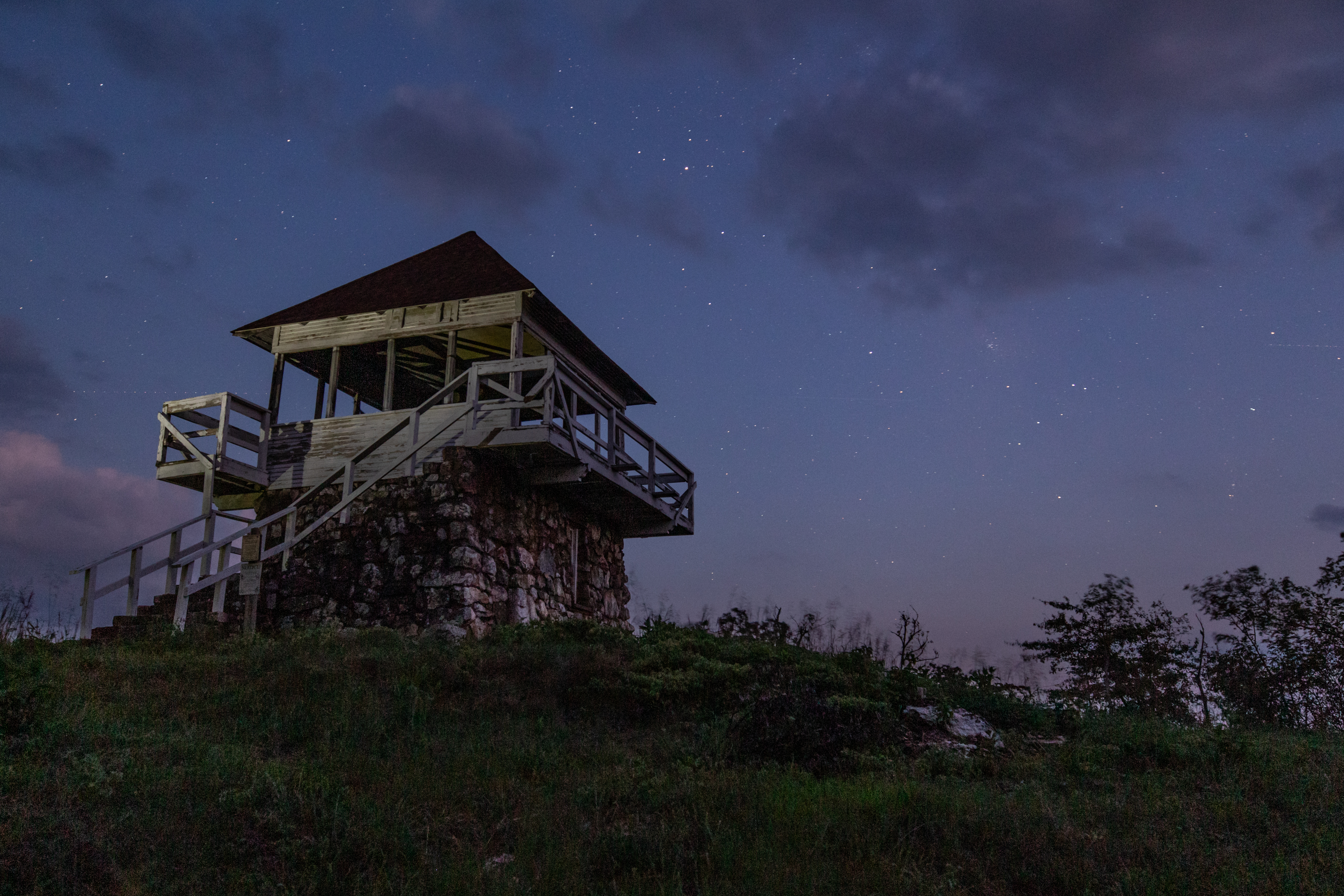 Stars coming out at dusk over Tall Peak Fire Tower in the Arkansas Ouachitas