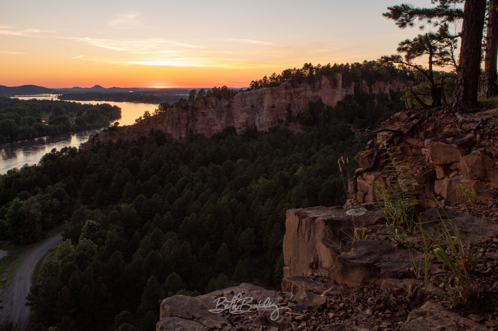 Sunset view of cliffs and Arkansas River with Pinnacle Mountain in the background of Emerald Park