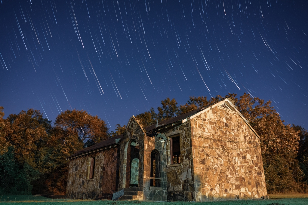 Star trails over an abandoned building in rural Arkansas