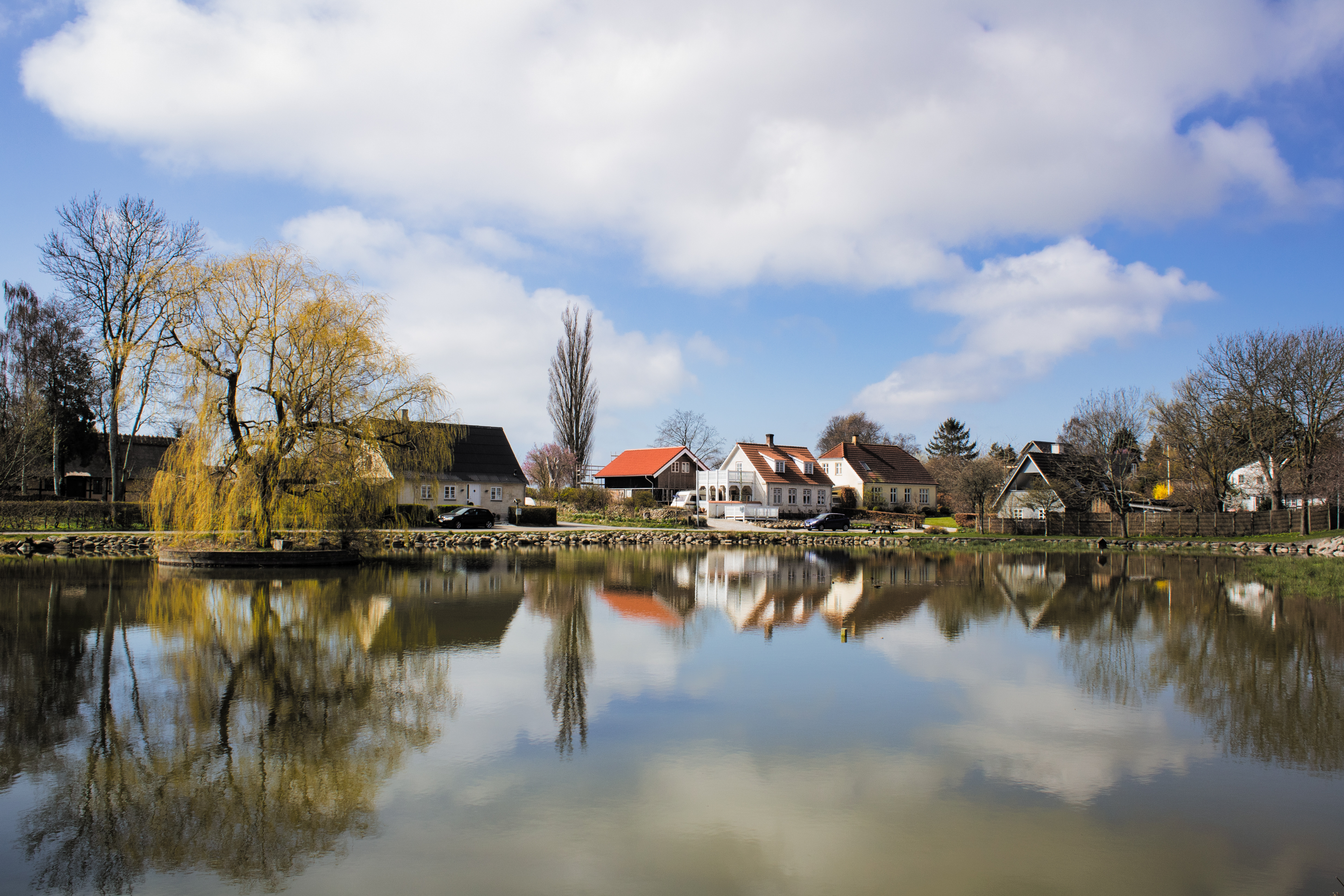 Peaceful scene in Denmark reflected in a pond
