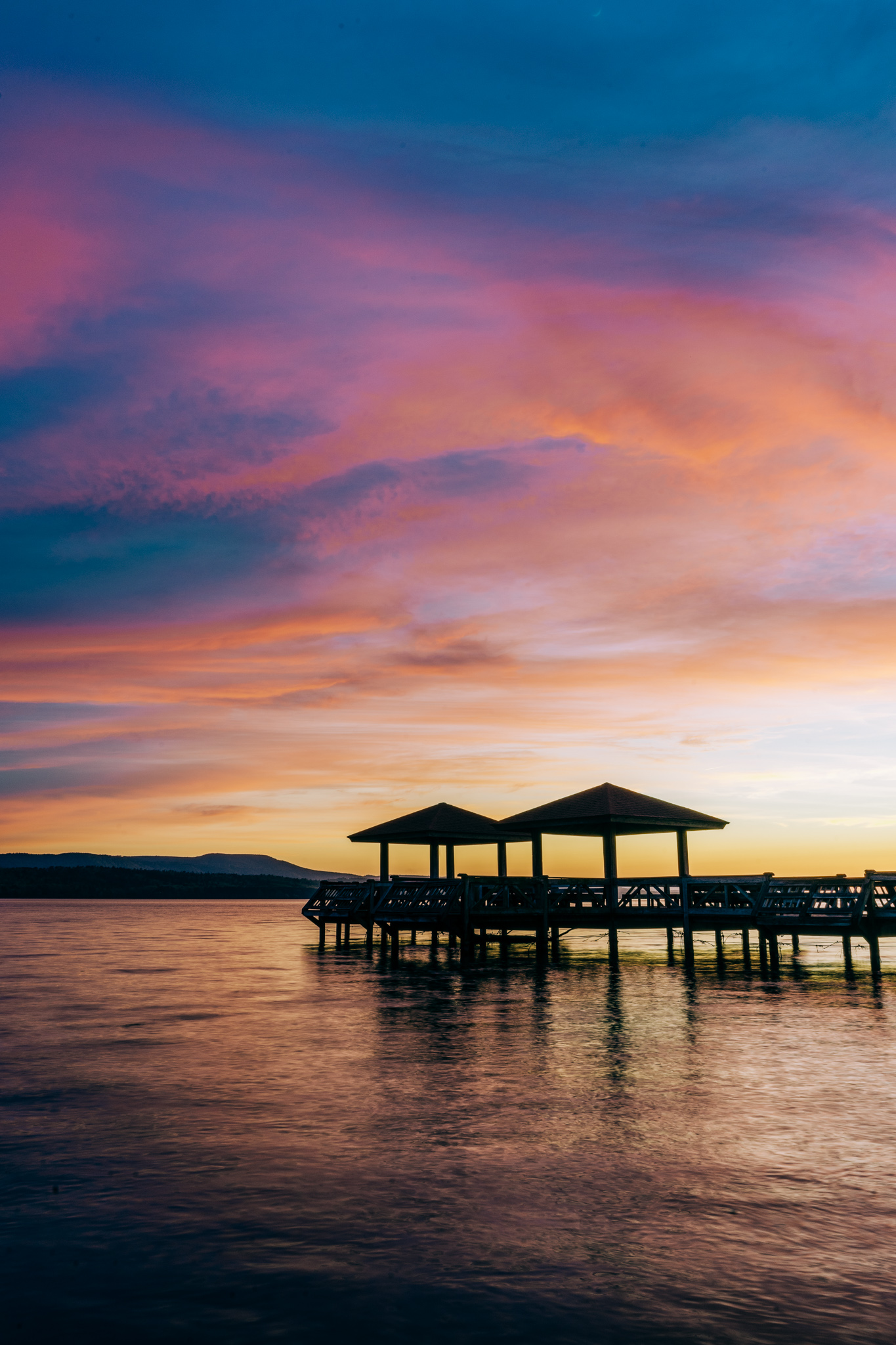 Sunset over a pier on Lake Dardanelle