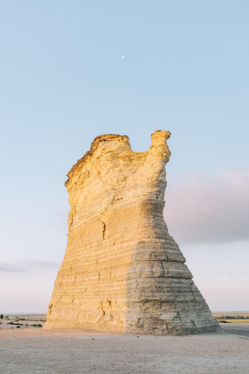 Sunrise and moon over Monument Rocks in Kansas